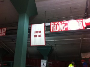 Fenway Park and a Boston Red Sox banner for the ballpark's 100 anniversary.